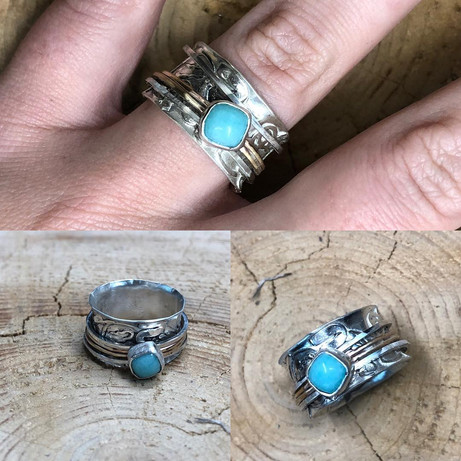 Spinner ring with larimar
