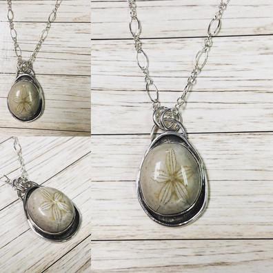 Petrified sand dollar pendant