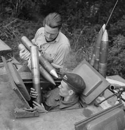 Loading ammunition into Churchill Tank - Normandy - 1944