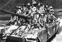 Soldiers Riding on Tank