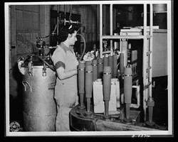 1943 Photo - Assembly line in large midwest artillery shell loading plant