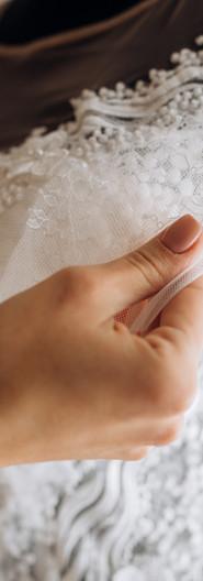 bride-adjusts-her-bridal-dress.jpg