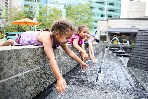 Children playing in a city fountain.jpg