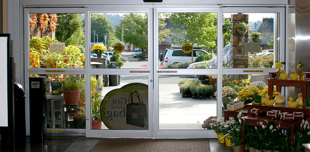 Sliding glass door entrance to grocery store