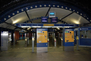 Entrance to Stortinget Metro station in Oslo Norway. Shows key card stations and informational area