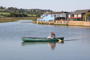 Boating on the River Brit in West Bay, Dorset