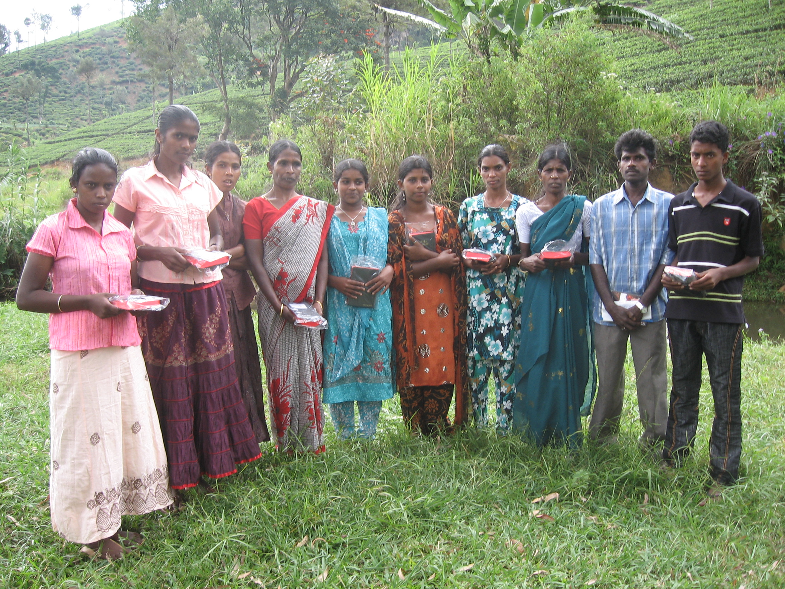 new believers receiving Bibles