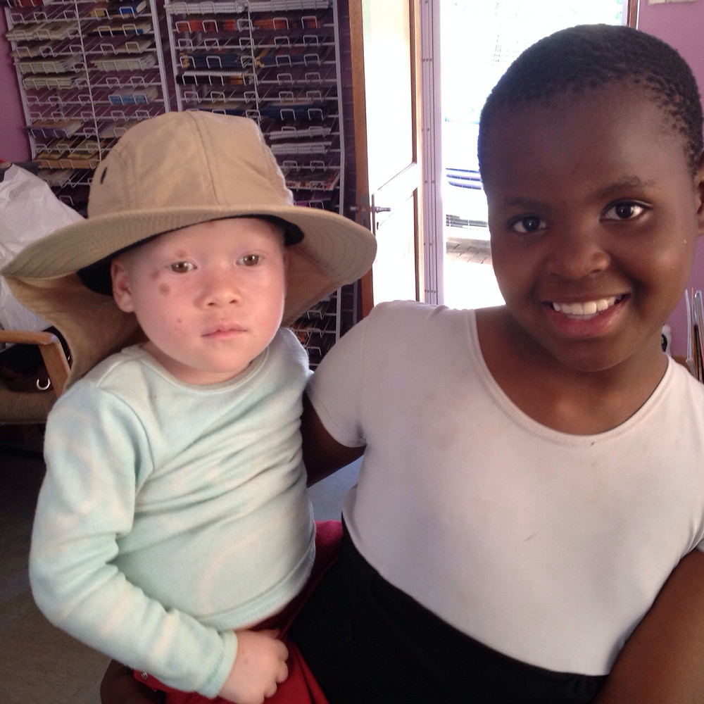 siphosethu with sun hat and big sister kayise.jpg