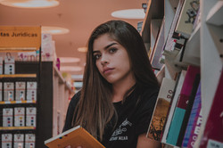 woman-in-black-top-leaning-by-bookcase-2