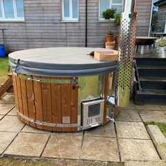 Wood fired hot tub by Penguin Spas Outdoor Living Scotland with LED lights 2.jpg