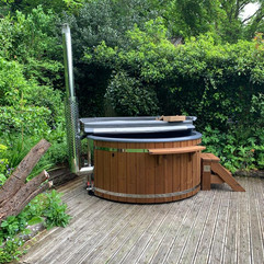 Wood fired hot tub by Penguin Spas Outdoor Living Ireland with LED lights 2.JPG