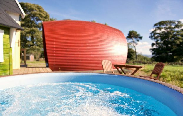 """The Rowan Pod - Total Glamping/Camping Experience with Style! Complete with your own ensuite shower room, loo and washbasin, galley kitchen, decking area with tables and chairs and your very own BBQ hut plus a beautiful hot tub, there is no better way to """"camp""""."""