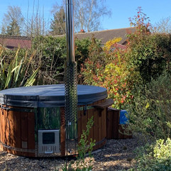 Wood fired hot tub by Penguin Spas Outdoor Living England with LED lights 2.JPG
