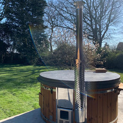 Wood fired hot tub by Penguin Spas Outdoor Living England 1.JPG