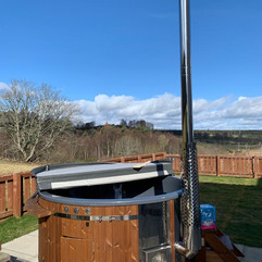 Wood fired hot tub by Penguin Spas Outdoor Living Glasgow with LED lights 2.JPG