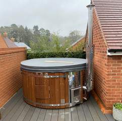 Wood fired hot tub by Penguin Spas Outdoor Living Scotland 1.jpg