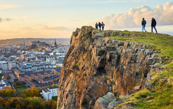 "Arthur's Seat is an extinct volcano which is considered the main peak of the group of hills in Edinburgh, Scotland, which form most of Holyrood Park, described by Robert Louis Stevenson as ""a hill for magnitude, a mountain in virtue of its bold design""."