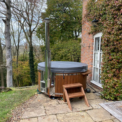 Wood burning hot tub by Penguin Spas Outdoor Living Ireland with LED lights 2.jpg