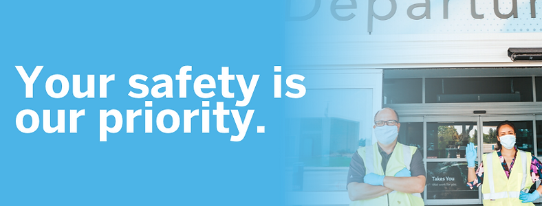your safety is our priority banner with two employees in masks