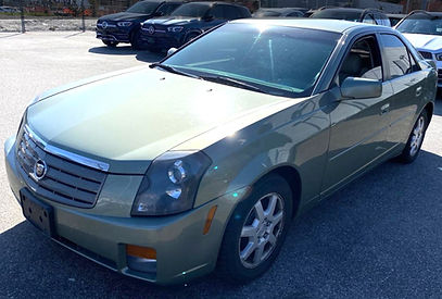 Driver side front corner 2005 light green Cadillac STS