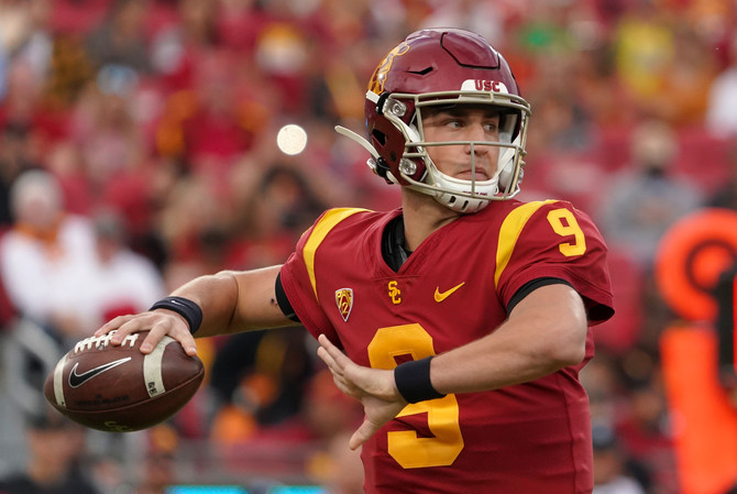 College Football Roundup: COVID Consequences; Heat on Harbaugh; Mississippi Misery; Pac-12 Lucks Out