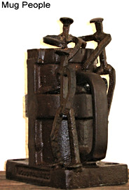 """May 2009 Industrial vibrator body, miniature RR spikes 11"""" x 9.5"""" x 9"""" approx. 40 lbs."""
