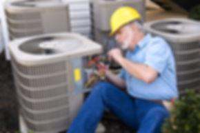 Air Conditioning Repairman At Work.jpg