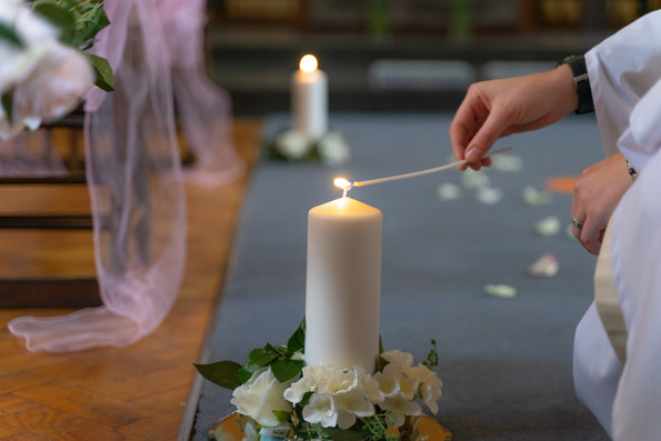 Lighting the candles for the wedding ceremony