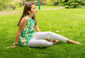 Teenager sitting on grass