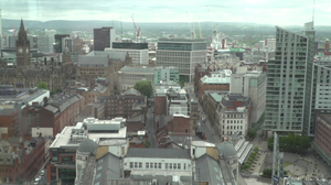 The landscape of Manchester City Centre on an overcast summer morning.