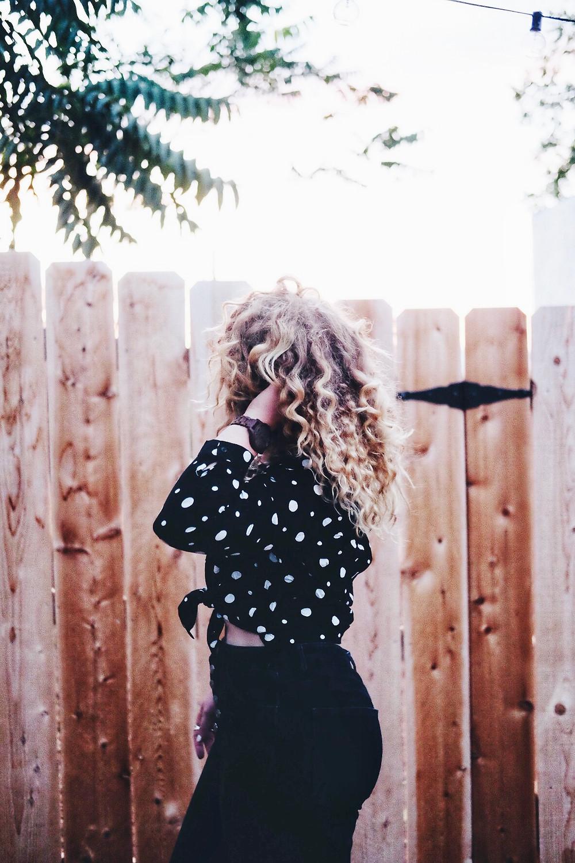 polka dot shirt, black and white shirt, jord watch,  black jeans, natural hair,