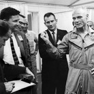 John Glenn was surrounded by the curious after his orbital flight. In this photo he is fla