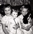 Sisters and their dolls, 1950s.jpg
