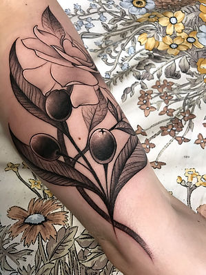 flower pod tattoo