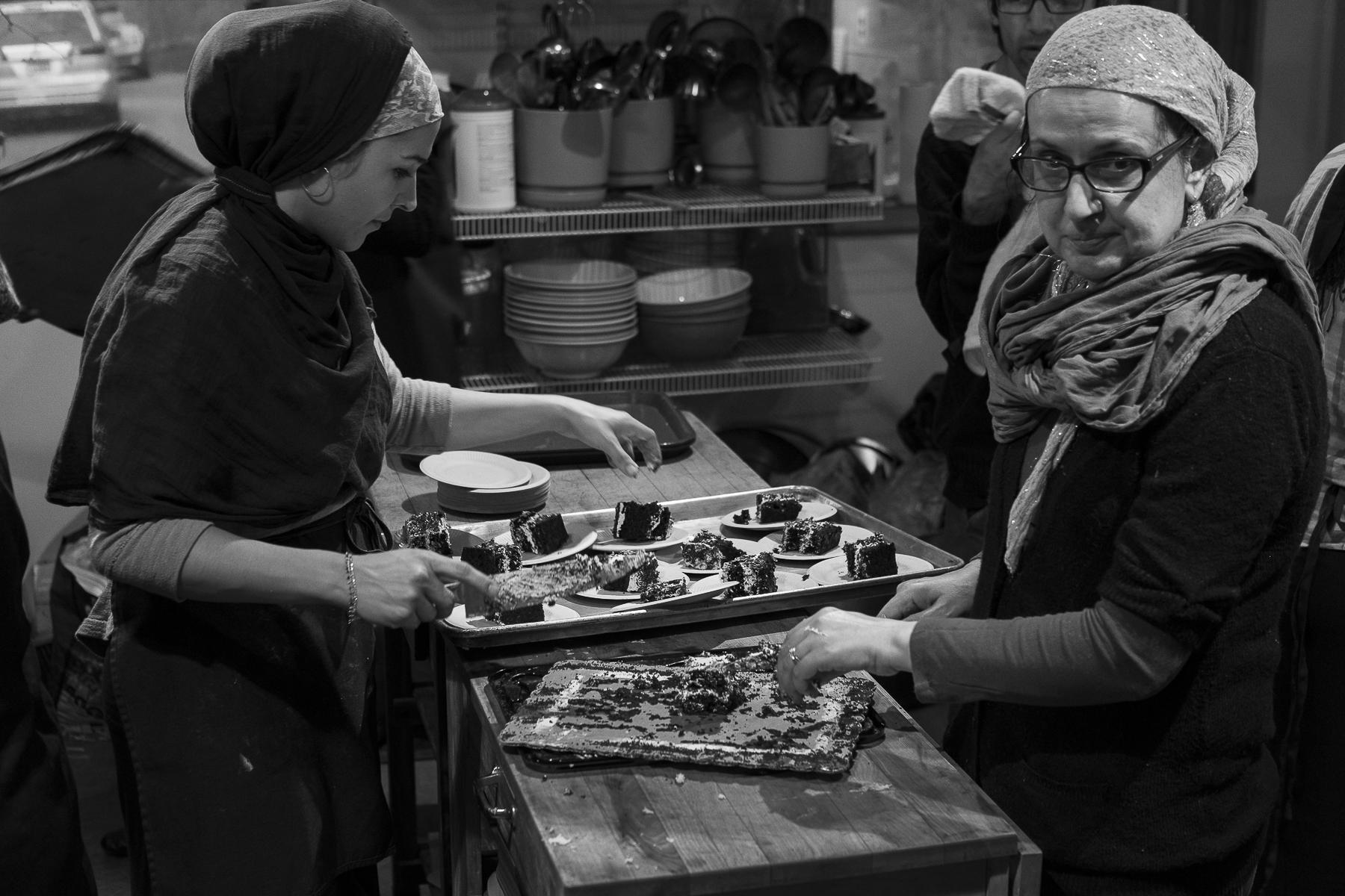 Women prepare and serve dessert