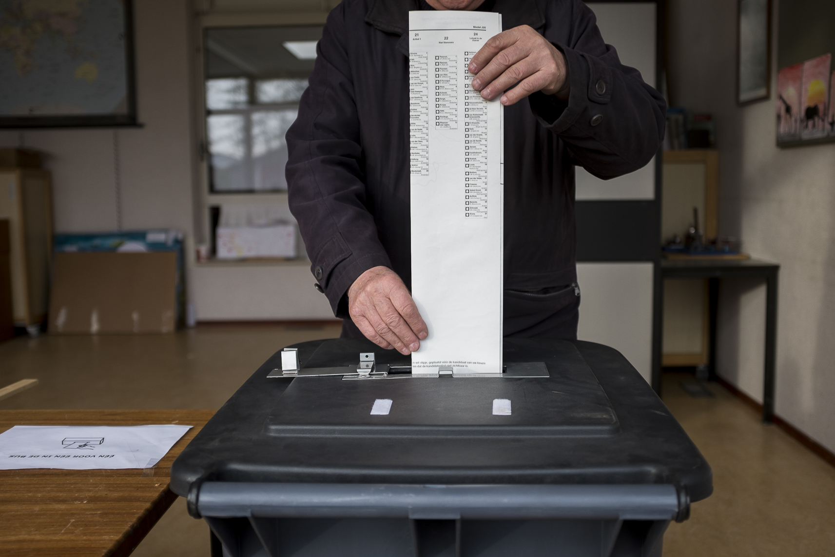 A man casts his ballot for the Dutch general elections at a polling station set up in a school in Staphorst, Netherlands, Wednesday, March 15, 2017.