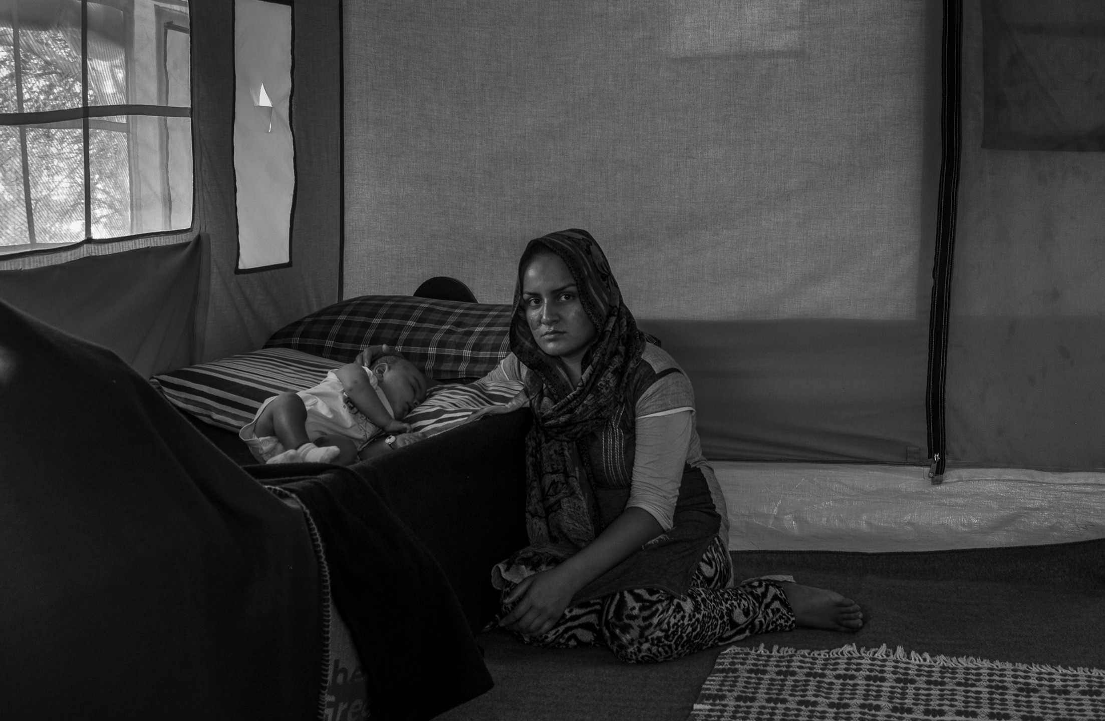 Munira Shahkar, 20, from Afghanistan, is currently staying in a camp in Oinofyta, a small town on the outskirts of Athens.