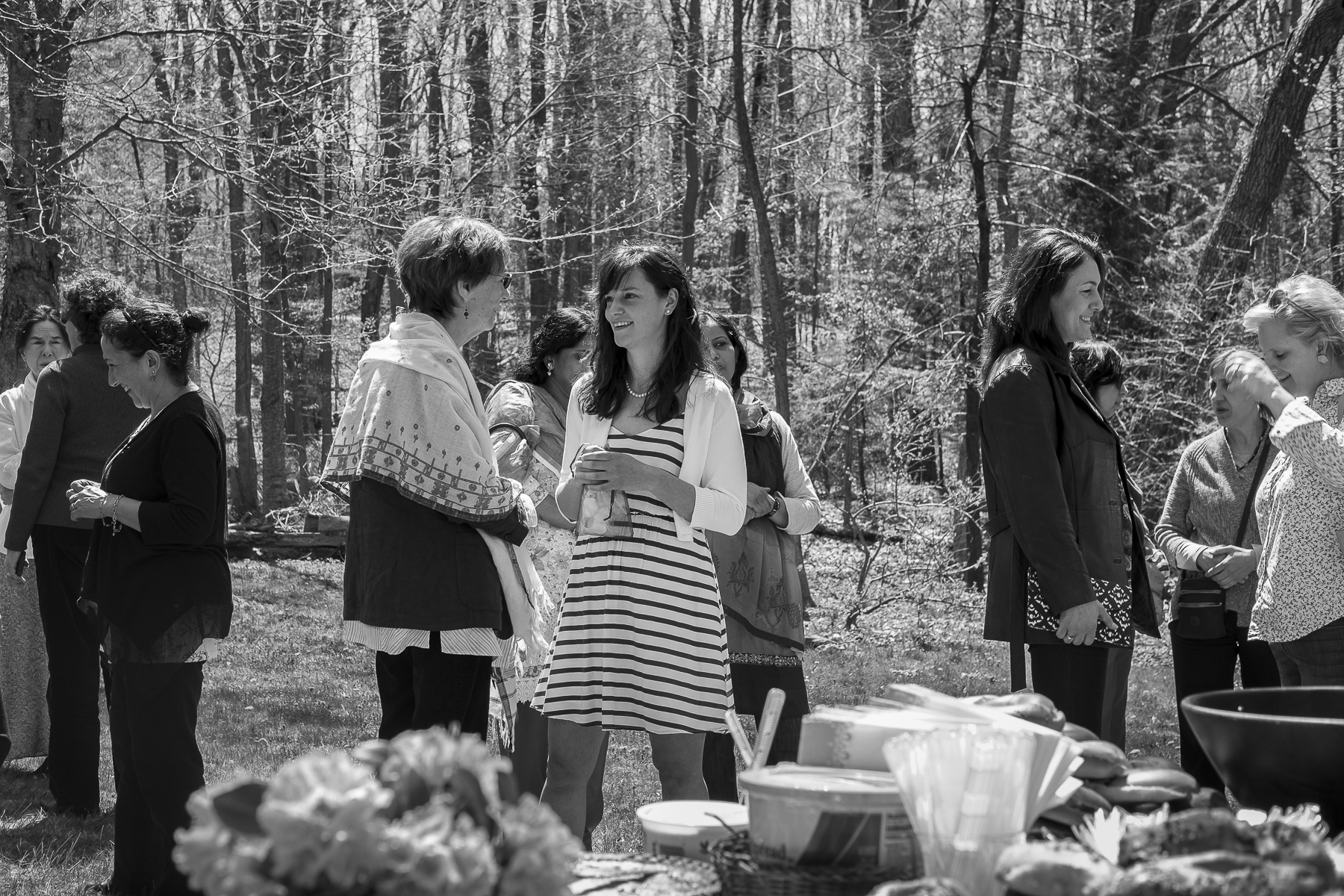 """Sara Gordon, the daughter of American converts, speaks to sheikh Tosun Bayrak's American wife, Jeanne Bayrak, during her bridal shower in April 2016. The mosque members are a colorful mix of Americans, Africans, Arabs, Iranians, Turks, Pakistanis, and, characteristic of America, many """"hybrid"""" families—including half Turkish half/American and half Brazilian/half Irish-American families."""