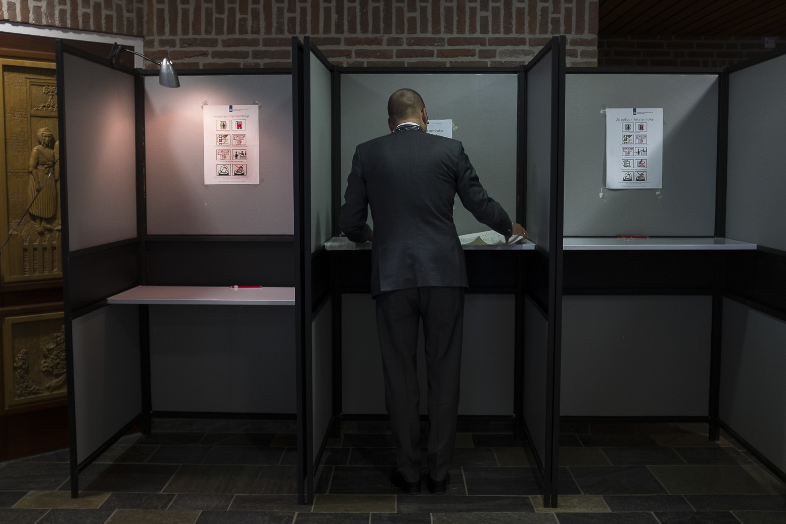 The mayor of Staphorst casts his ballot for the Dutch general elections at a polling station set up in the townhall in Staphorst, Netherlands, Wednesday, March 15, 2017.