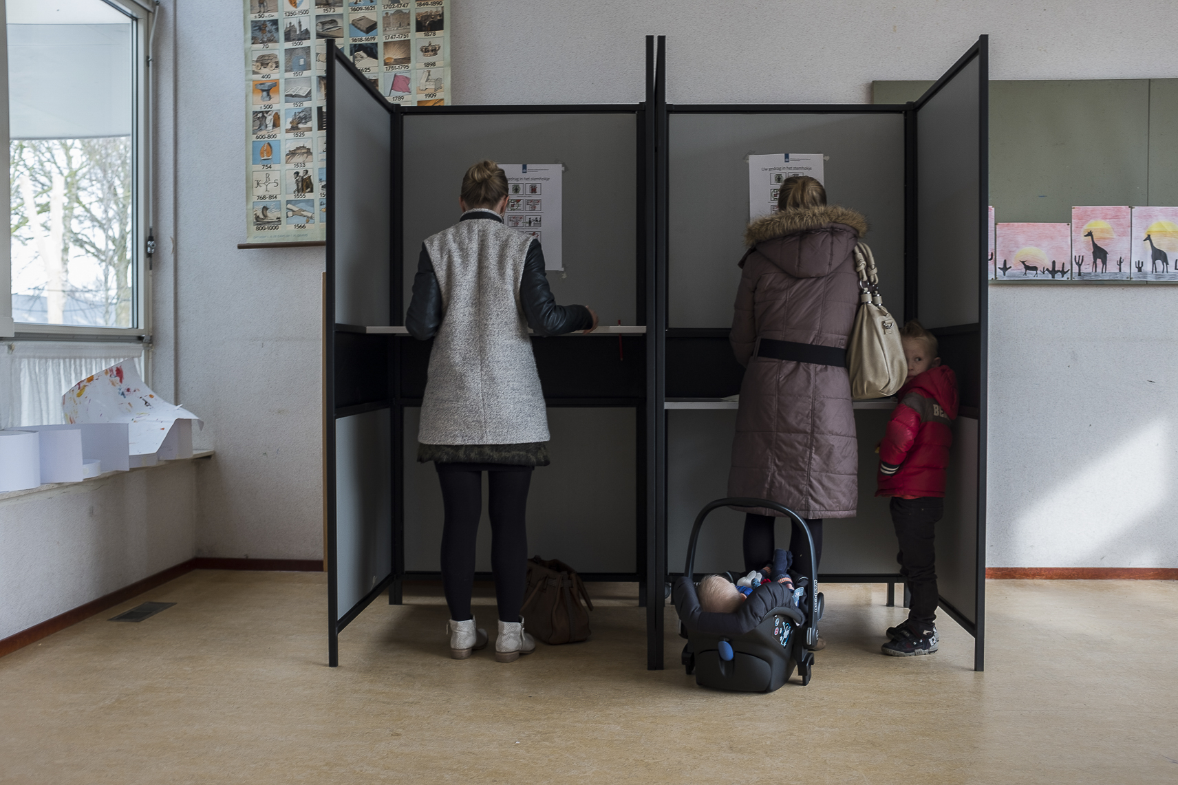 Women casts their ballots for the Dutch general elections at a polling station set up in a school in Staphorst, Netherlands, Wednesday, March 15, 2017.