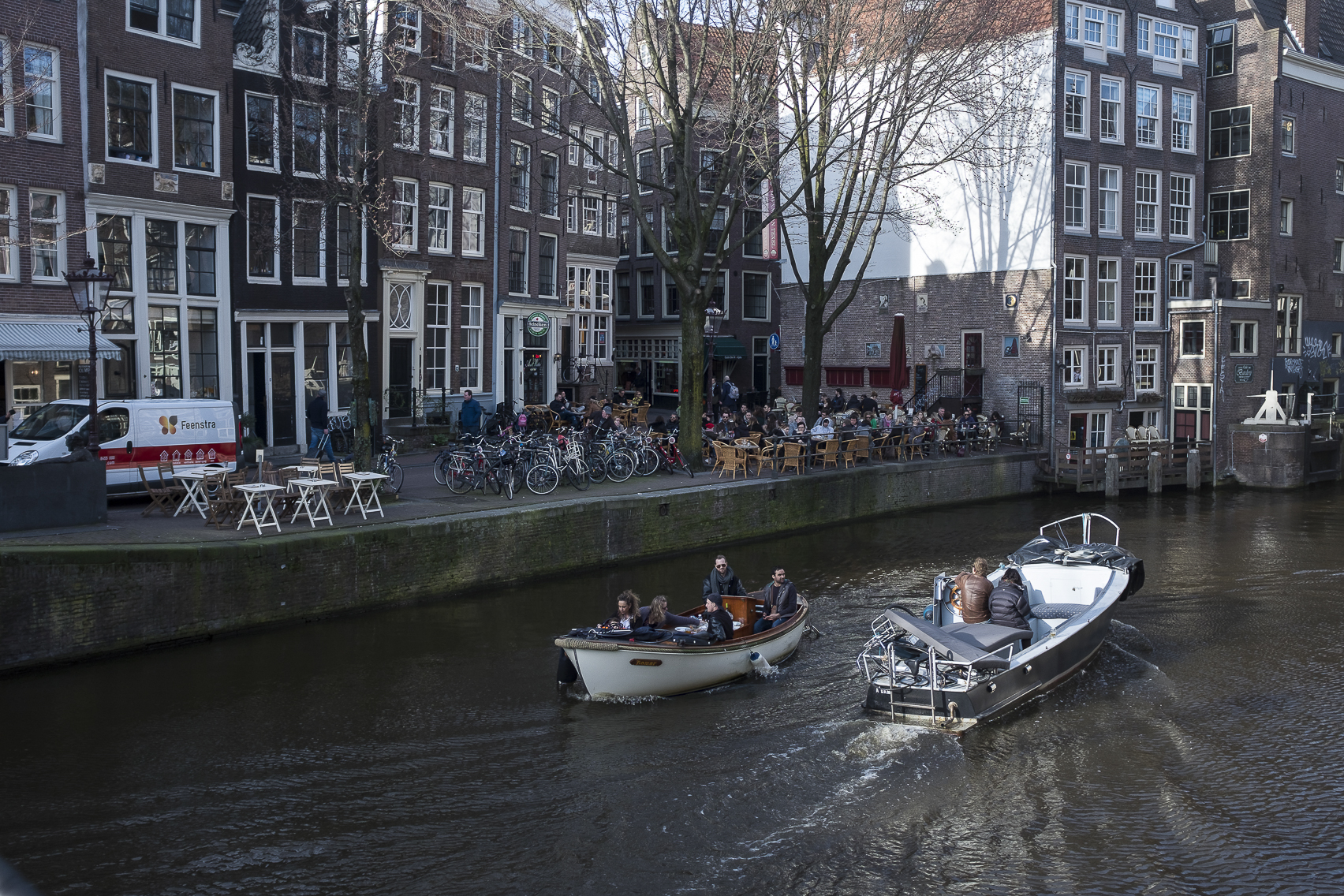 Boats pass on the canals in Amsterdam, Netherlands. March 12, 2017.