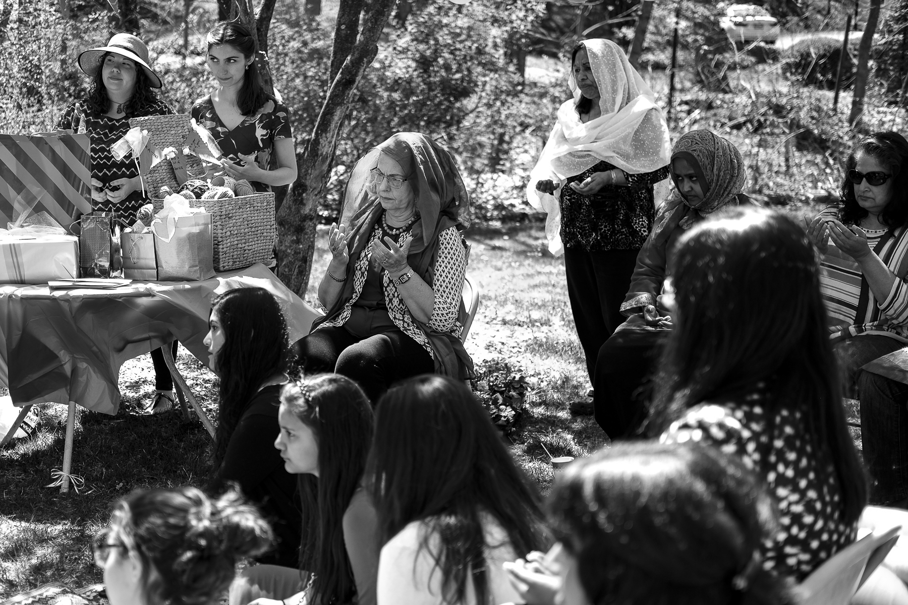 Several generations of Muslim women offer prayers and blessings to the bride. These women and girls come from a multitude of countries and cultures, yet all have come together to celebrate the marriage of Sara Gordon to Jamal Halawa, a Palestinian-American from Boston. The bridal shower was a blend of East and West, young and old.