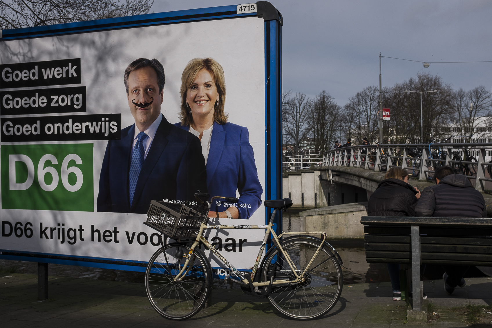 A billboard in Amsterdam, Netherlands with de-faced posters of the candidtes in the Dutch general elections. March 14, 2017.