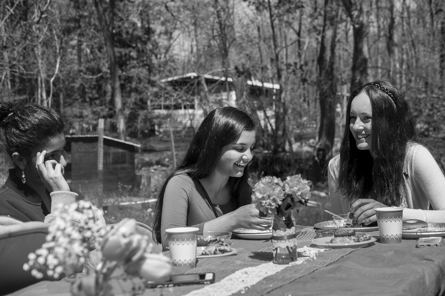 The younger generation of girls sits at the end of the table and laugh amongst themselves. As with most other groups of immigrants from around the world, each generation becomes more integrated into society, maintaining less and less of the traditions of their parents. For the children of American converts, like Sara Gordon, there was never a cultural hurdle to get over. But other children, like these young girls, have to find the balance.