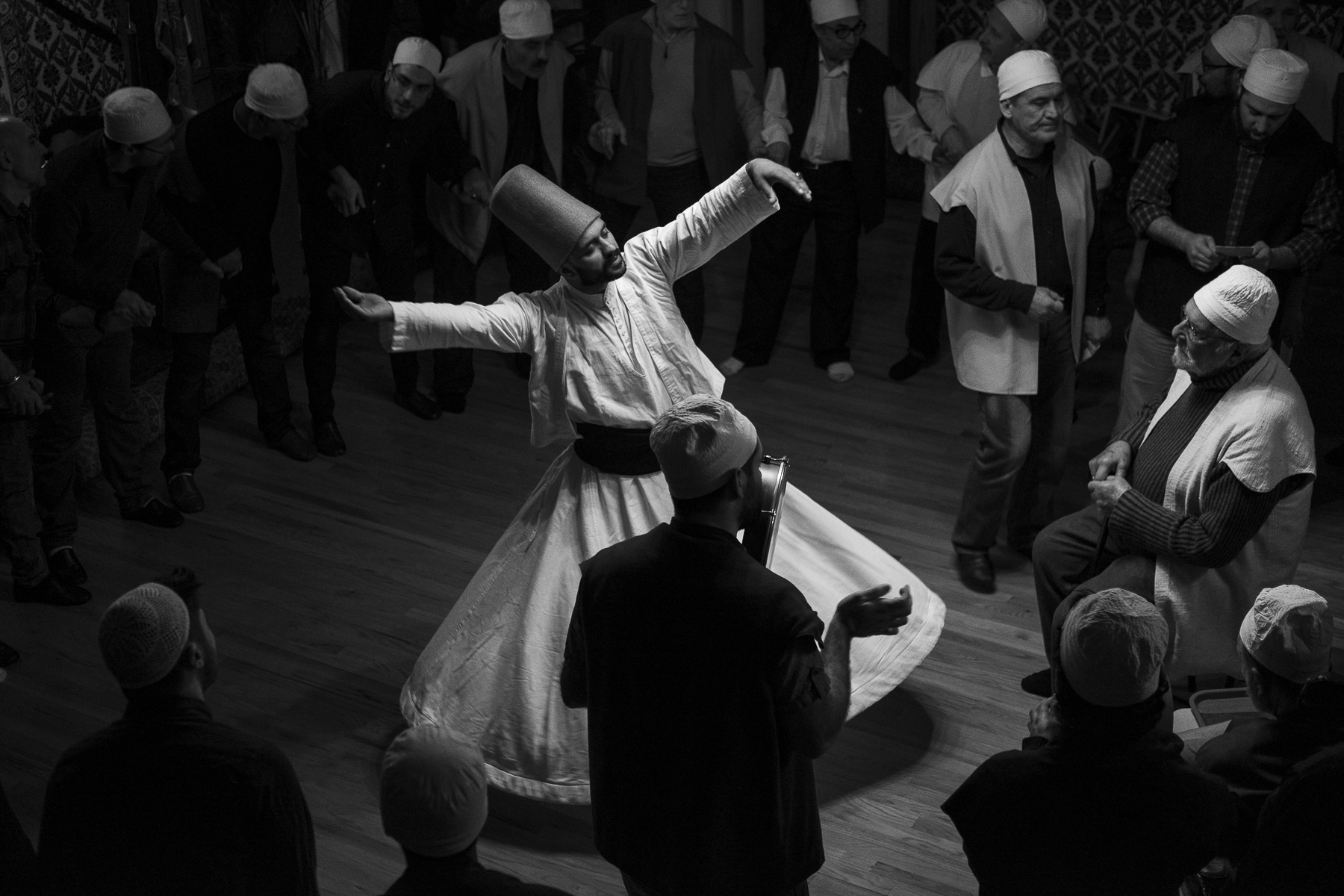 A whirling dervish from Istanbul performs during the Zikr ceremony. The members of the Jerrahi Order of America meet every Saturday night for dinner, prayers and special ceremonies, including the Zikr. Sheikh Tosun Bayrak, 90, conducts the Zikr ceremony from a seated position.