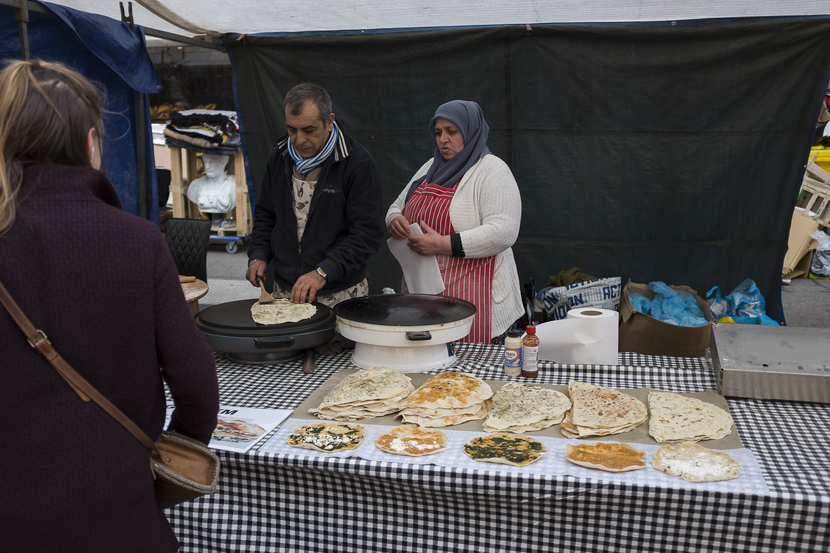 A couple sells Turkish food at a local street market in Amsterdam, Netherlands. March 14, 2017.