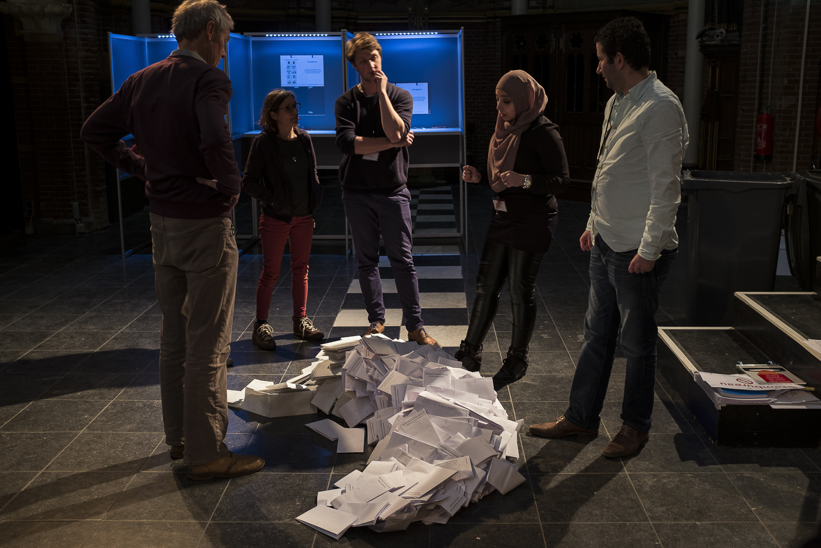 Election workers begin counting the ballots at a local voting center set up in a church in Amsterdam, Netherlands, Wednesday, March 15, 2017.