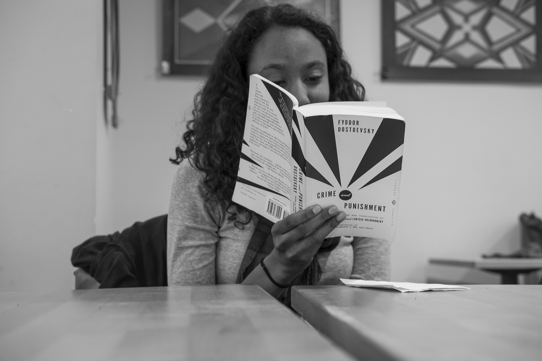 Nadia Celestine, a senior at Green Meadow Waldorf School in Chestnut Ridge, reads a book assigned in one of her classes. Nadia's mother is Turkish and her father is Haitian American. Nadia and her family are long-time members of the Jerrahi Order of America.