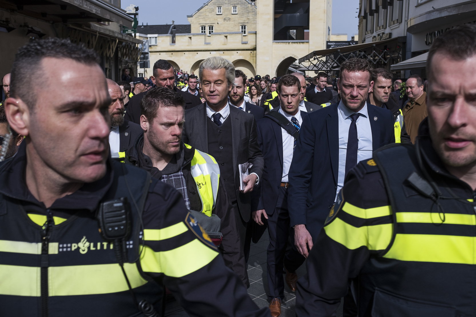 Firebrand anti-Islam lawmaker Geert Wilders is surrounded by his security during a campaign rally for the Dutch general elections in Heerlen, Netherlands, on March 11, 2017.
