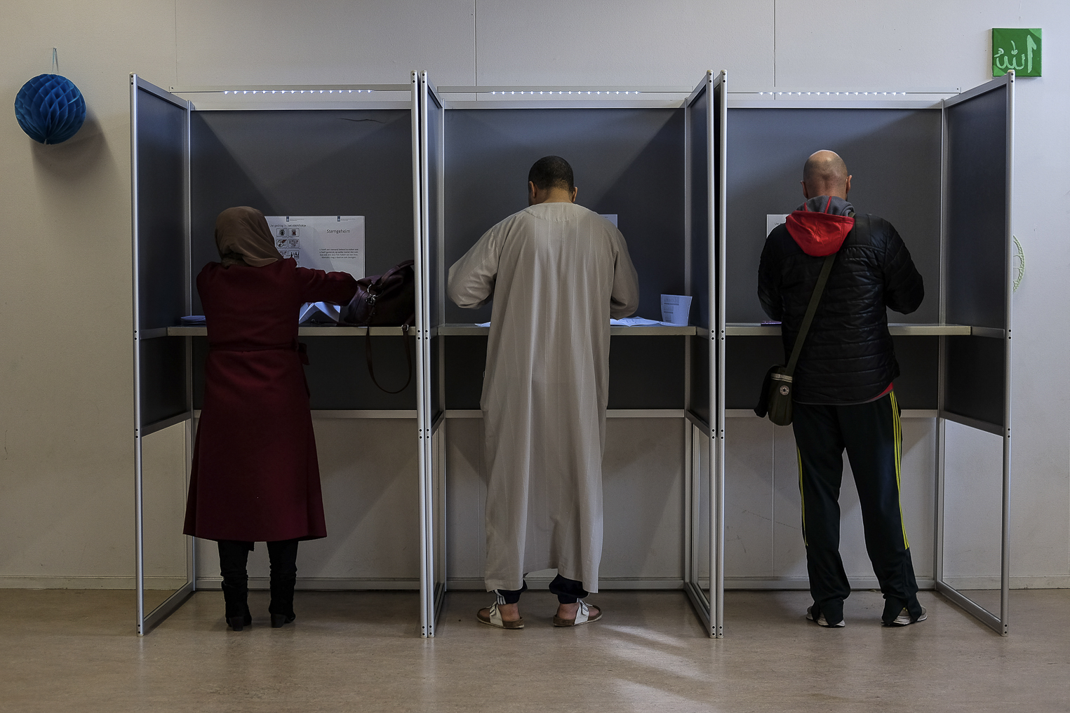Voters cast their ballots at a local voting station in Amsterdam, Netherlands, Wednesday, March 15, 2017.